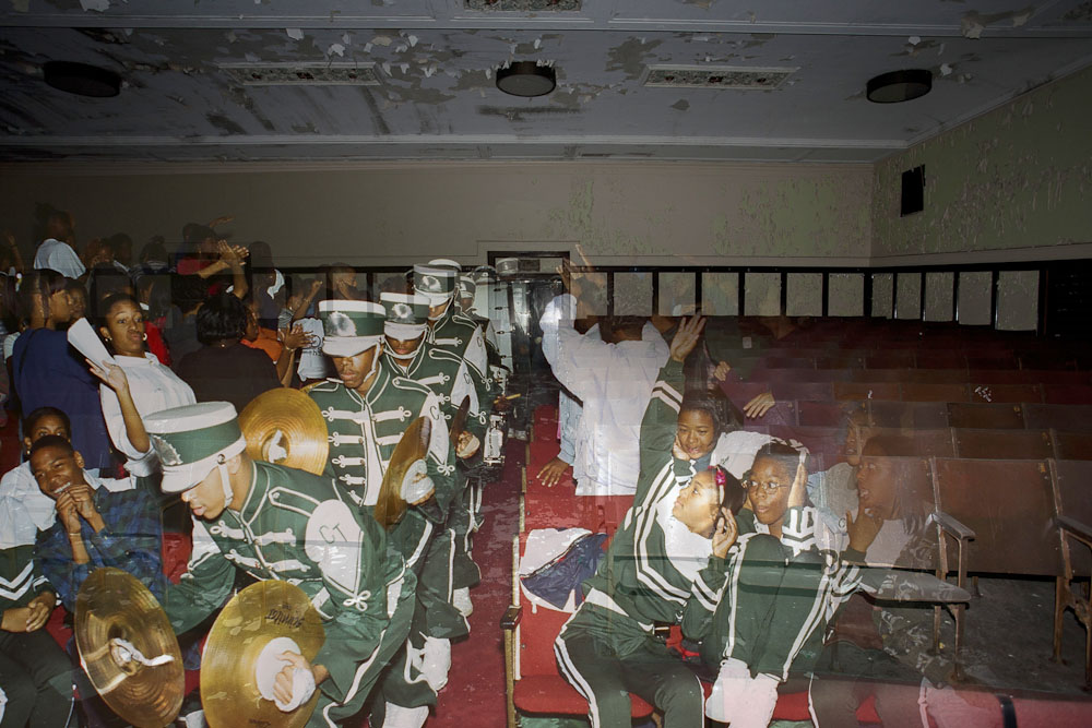 Pep band makes their way through a crowd.